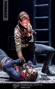 Coriolanus (Tom Hiddleston) and Aufidius (Hadley Fraser).  Photo by Johan Persson.